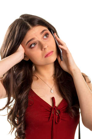difficult lives: Bored woman holds cell phone. Small pendant on girls neck. Your offer doesnt interest me. Its a waste of time. Stock Photo