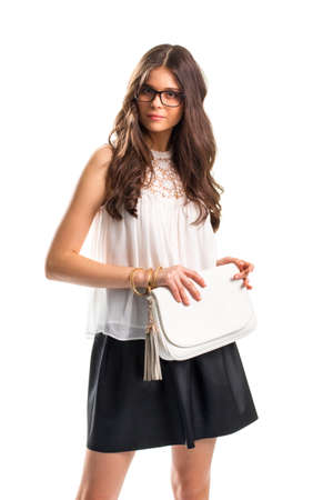 Lady wears blouse with insert. White top and handbag. Attractive girl in glasses. Evening apparel for summer.