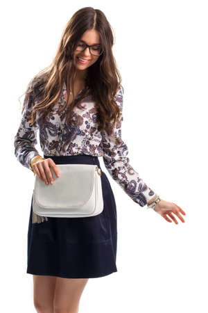 with ease: Lady in floral shirt smiling. Shirt with print and skirt. Model in glasses is posing. Ease and style.