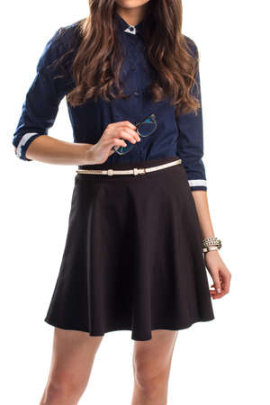 secretary skirt: Girl in shirt holds glasses. Black skirt with white belt. Intelligence and beauty. Well-dressed secretary.