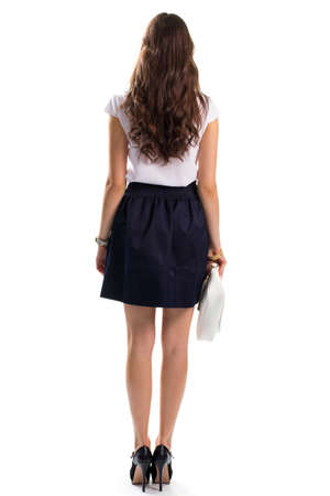 clutch bag: Girl wears white blouse. Back view of navy skirt. Clothing with shoes and accessories. White leather clutch bag. Stock Photo