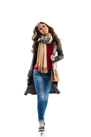 outerwear: Lady is walking and smiling. Black and gray sweater coat. Model in spring outerwear. Trendy and comfortable clothes.