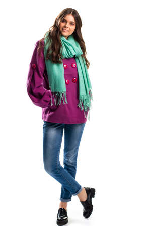 outerwear: Girl in short purple coat. Black shoes and turquoise scarf. Colorful outerwear for autumn. Combination of attractive colors.