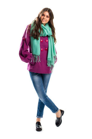 outerwear: Lady in purple coat smiling. Scarf and black glossy shoes. Simple design of spring outerwear. Look stylish in any weather.