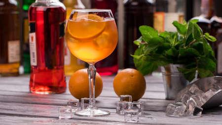 spritz: Orange drink in wineglass.