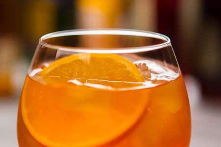 spritz: Glass with orange beverage with Slice of fresh orange. Stock Photo