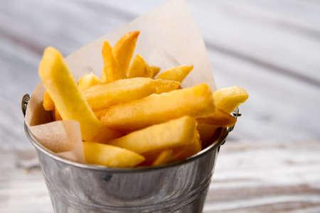 Bucket with yellow fries. Banco de Imagens - 60327762