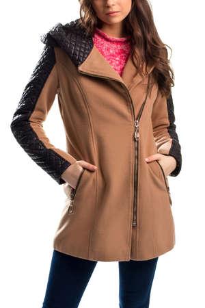 black sweater: Woman wears beige coat, Short coat with inserts.