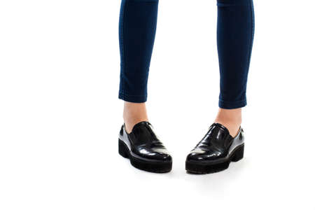 footwear: Ladys legs in Black glossy footwear.