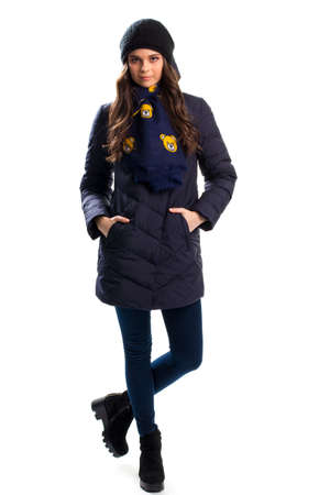 pants down: Girl in navy down jacket, Dark pants and ankle boots.