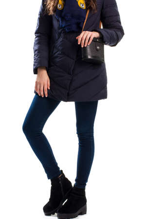 ankle strap: Girl wears navy down jacket, Boots and bag with strap.