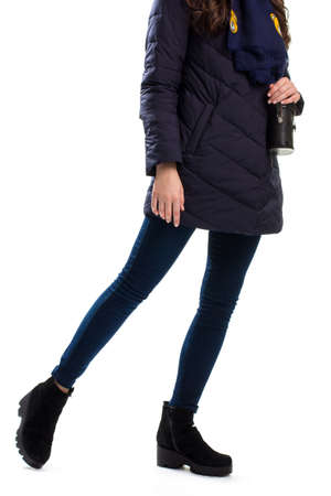 pants down: Lady wears navy down jacket, Black boots and skinny pants.