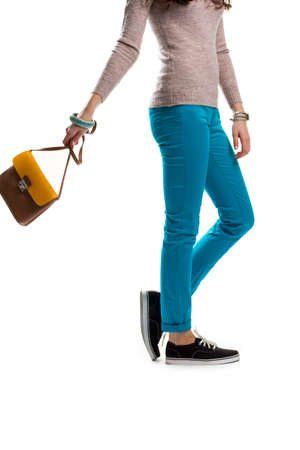 Woman in turquoise pants, Black shoes and beige top. Stock Photo