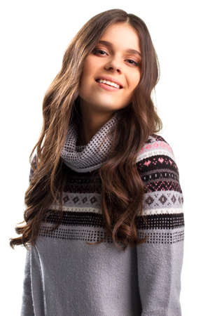 pullover: Girl in pullover is smiling. Stock Photo