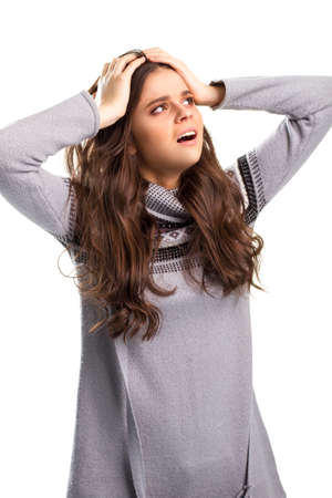 holding on head: Woman holding head with hands. Stock Photo