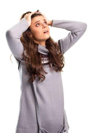 sweatshirt: Girl holds head with hands.
