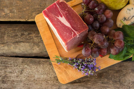 fresh taste: Lavender flowers and raw meat. Grapes and cheese with mold. Taste of organic food. Fresh pork for steak. Stock Photo