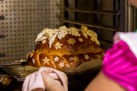 oven tray: Decorated bread on oven tray. Baked product of brown color. Wedding bread is ready. Tasty dish for ceremony.