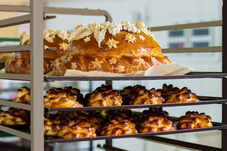 sweet treats: Decorated loaf and buns. Pastry on a rack. Food cooked at the bakery. Wedding bread and sweet treats.