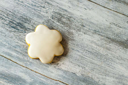 flower shape: Small cookie shaped as flower. Biscuit with white glazing. Homemade dessert for a child. Little amount of calories. Stock Photo