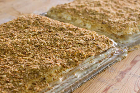 biscuit dough: Big layered dessert. Biscuit crumbs and cream. Traditional recipe of napoleon cake. Fresh puff dough. Stock Photo