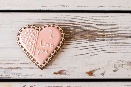 warmth: Heart cookie with inscription. Pink frosted biscuit. The most important message. Convey the warmth of heart. Stock Photo