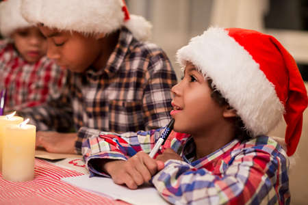 afro kids write christmas letter making a christmas wish