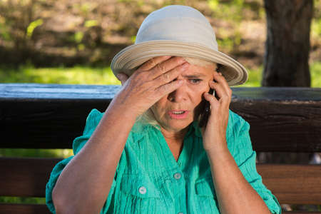 phone calls: Scared woman with cell phone. Senior lady in a hat. Children are in trouble. No time to think.