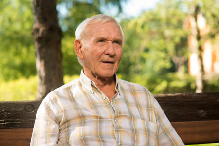 Elderly man with thoughful face. Portrait of senior male. Time runs like water. Live in peace with yourself. Stock Photo