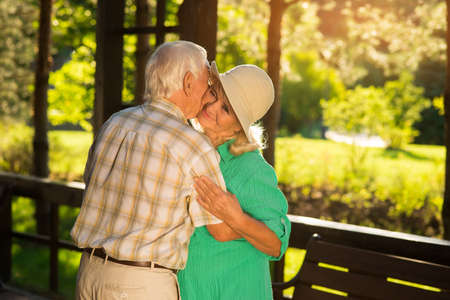 only one senior: Elderly couple is hugging. Smile of senior woman. Thanks for all the years. My one and only. Stock Photo
