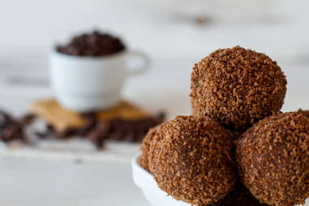 Brown ball shaped desserts. Candies with crumbs. Cookies and sugar. Sweet dish from russian cuisine. Stock Photo