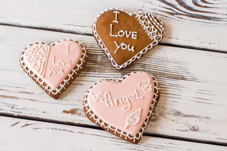 confess: Three heart cookies. Glazed biscuits with inscription. Small gifts bring heart warmth. How to confess in love.