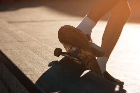 coordination: Feet and skateboard. Skater doing grind trick. Perfect coordination of movements. Skill of extreme sportsman.