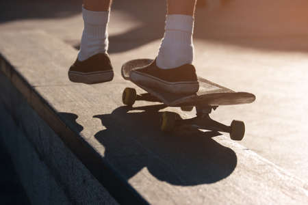 no fear: Foot on a skateboard. Skater riding outdoors. No fear and no doubt. Be young and live free.