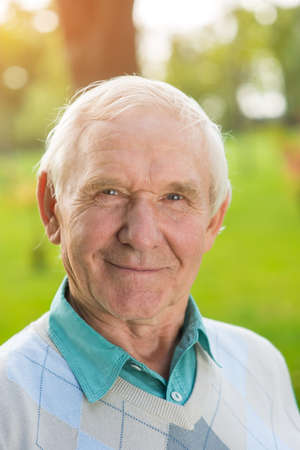time flies: Elderly man looking at camera. Portrait of smiling male. Dreams turn into achievements. Time flies like an arrow. Stock Photo