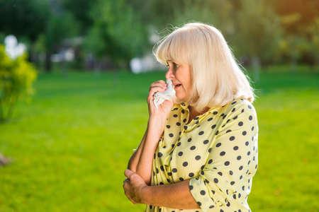 cruel: Elderly woman crying. Older lady outdoors. My heart is broken. Fate is cruel.