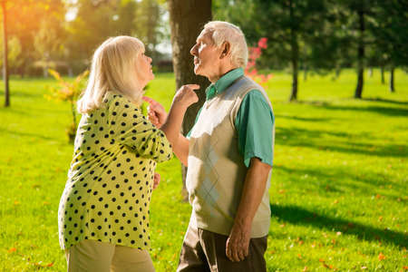 Couple pointing at each other. Man and woman standing outdoor. Escalation of conflict. Youre acting like a fool. Stock Photo