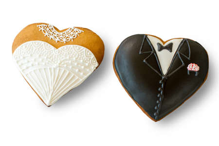 Wedding cookies on white background. Biscuit shaped as tuxedo. Sweet treats for loving hearts. Best regards to newlyweds.