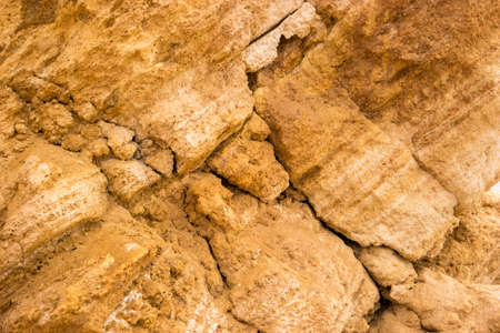 place of research: Yellow rock texture. Stones with cracks. Mother nature builds might. Place of geological research. Stock Photo