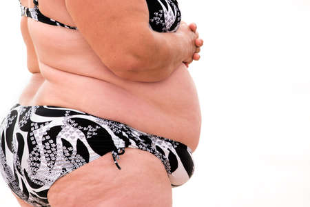 constant: Fat body isolated. Side view of obese woman. Health in serious danger. Aftermath of constant overeating.