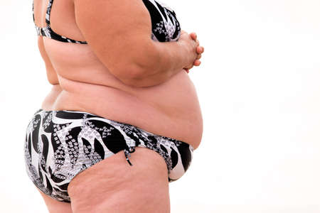heavy risk: Obese body on isolated background. Side view of obese lady. Save health from danger. You are what you eat.