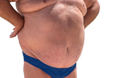 sedentario: Gran barriga del hombre. aislado hombre con sobrepeso. Aumento del riesgo de hernias. La mala dieta y estilo de vida sedentario. Foto de archivo