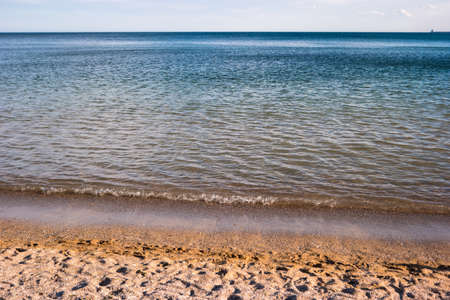 warm climate: Sky and seashore. Sand and water. Nice place for summer vacation. Warm tropical climate.