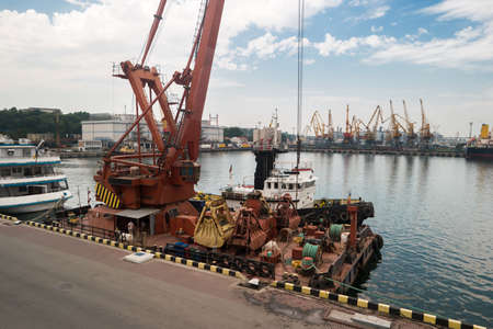 durable: Crane on the pier. Port at daytime. Heavy and durable. Maintenance of ships.