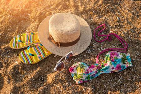 go for: Sunglasses and hat on sand. Colorful swimsuit top. Meet the summer. Go for a swim.