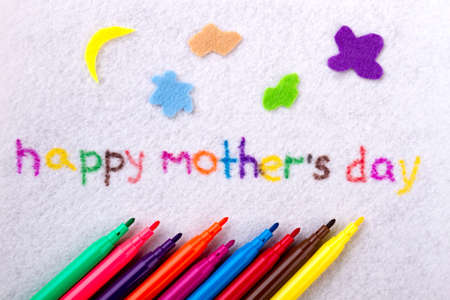 Happy Mother`s Day text. Inscription and felt-tip pens. Develop your imagination. Handmade for moms from kids.