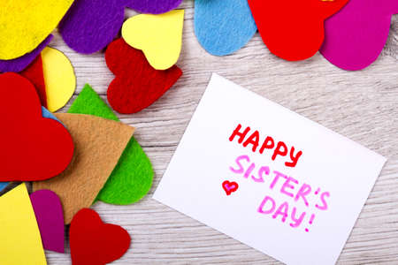 Happy Sister`s Day greeting card. Colourful hearts and greeting card. Sister is your best friend. Palette of love.