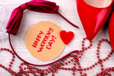 card making: Happy Women`s Day greeting composition. Bow hair band and card. Surprise your lady. Making a lovely present.