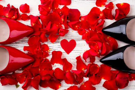 bunch of hearts: Red heart and rose petals. Petals, fabric heart and shoes. Symbols of love and tenderness. Stock Photo