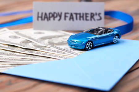 Fathers Day card and car. Cash in envelope and ribbon. Make dads dream come true.